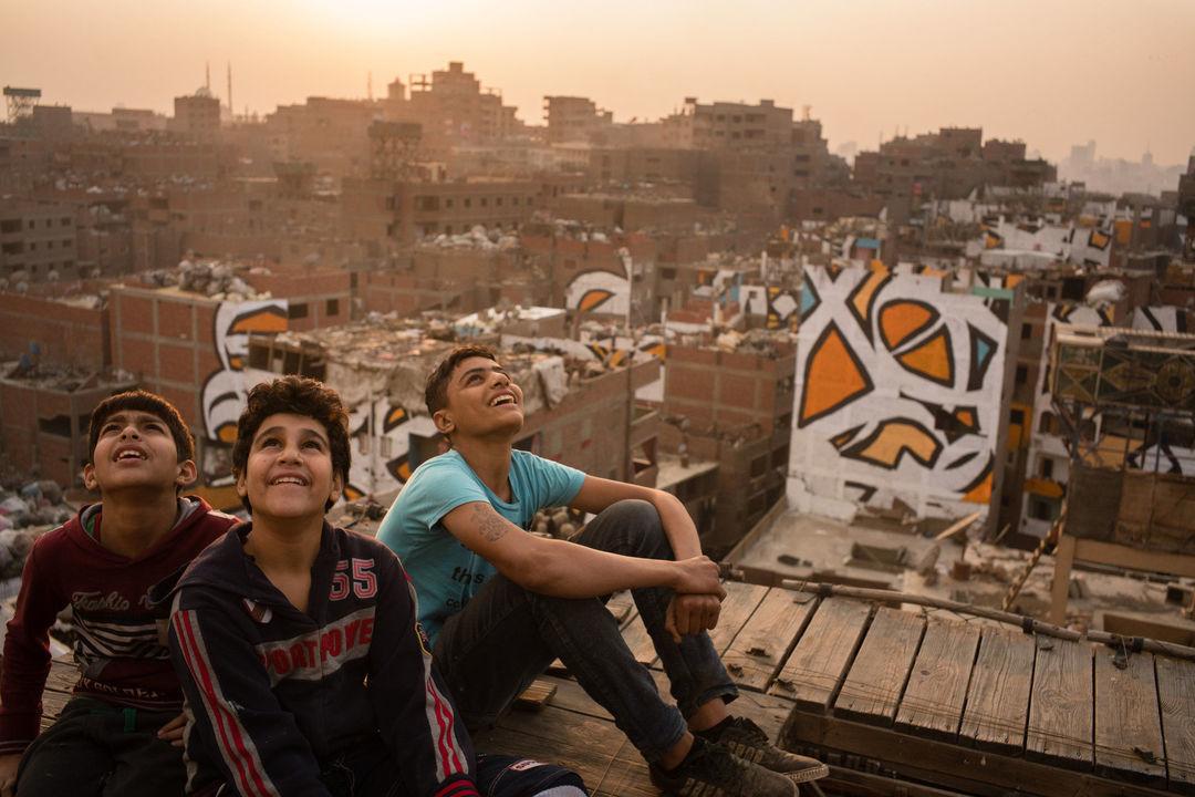 他们用一幅超大型墙绘,向开罗的拾荒者致敬_文化_好奇心日报