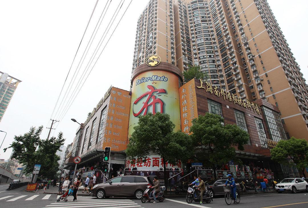 """聚集了300个裁缝铺的大楼,如何成为外国人在上海的""""高级定制""""?_设计_好奇心日报"""